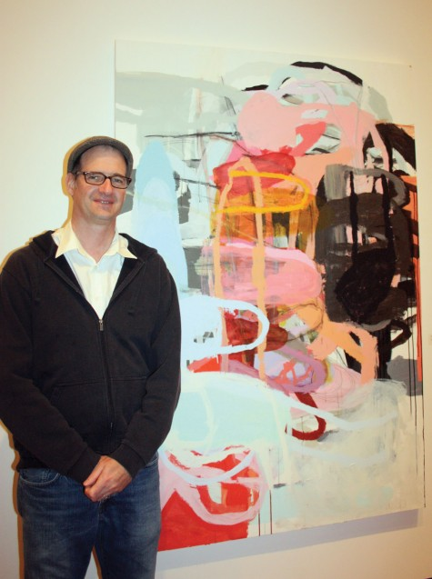 Newfoundland artist Will Gill stands beside one of the works in Bloodredlife, a show of 12 of its works which opened Thursday at Two Rivers Gallery. Allan WISHART/Free Press