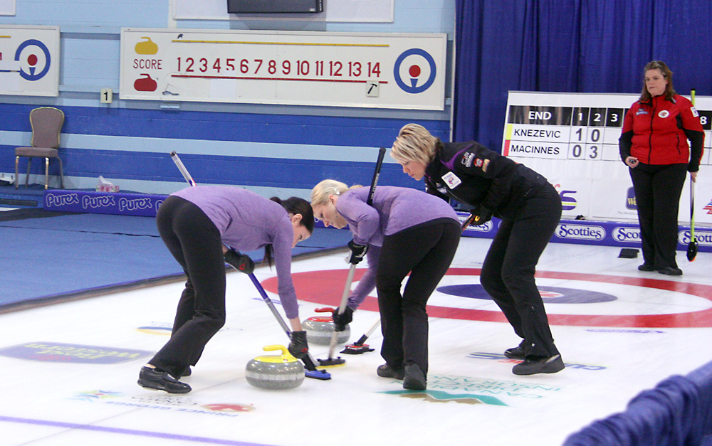 Skip Patti Knezevic jumps out to help her sweepers in a Page Playoff game Saturday morning at the Scotties BC Women's Culring Championships. Knezevic lost the game 12-6 to Allison MacInnes, who advances to the semifinal at 7 p.m. Saturday against Kesa Van Osch. Allan WISHART/Free Press