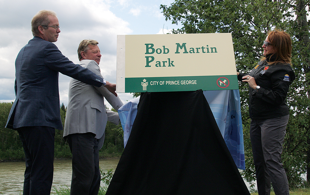 John Martin (left), Coun. Murry Krause and Mayor Shari Green officially dedicate Bob Martin Park Monday morning. Bob Martin, and his wife Anne, were both heavily involved in Prince George. Bob was an instructor at the College of New Caledonia and played a key role in community planning in the early 1970s. He served on city council from 1974-77. After retirement, he continued to be very involved in the community, as well as provincial and federal politics. Bob died November 27, 2012, justr 17 days after Anne. Bob Martin Park is located across Ferry Avenue from the Hospice House. Bill PHILLIPS/Free Press