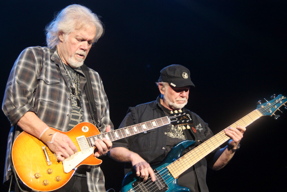 Randy Bachman, left, and Fred Turner get down to some serious guitar picking during their concert Monday at the CN Centre in Prince George.