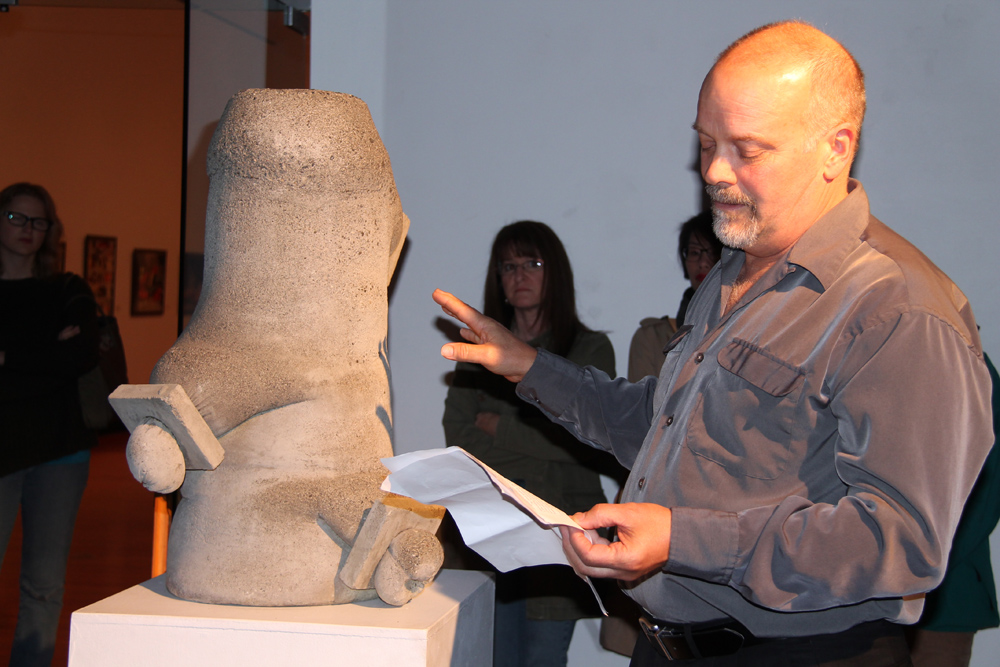 """If you cut off the pain, you cut off the joy..."" (Armstrong) Inspired by the intriguing sculptures by artist Phil Morrison on display at Two Rivers Gallery until Oct. 12, Michael Armstrong of Victoria, stands by Morrison's sculpture Desire and Discipline. He and other poets came together Thursday evening to share their written verse in a special event called 3-D Poetry. Teresa MALLAM/Free Press"