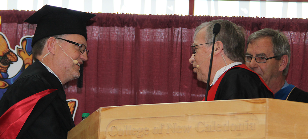Henry Reiser (left) is installed as president of the College of New Caledonia Friday by Supreme Court Justice Glen Parrett while CNC board chair Keith Playfair looks on. Bill PHILLIPS/Free Press
