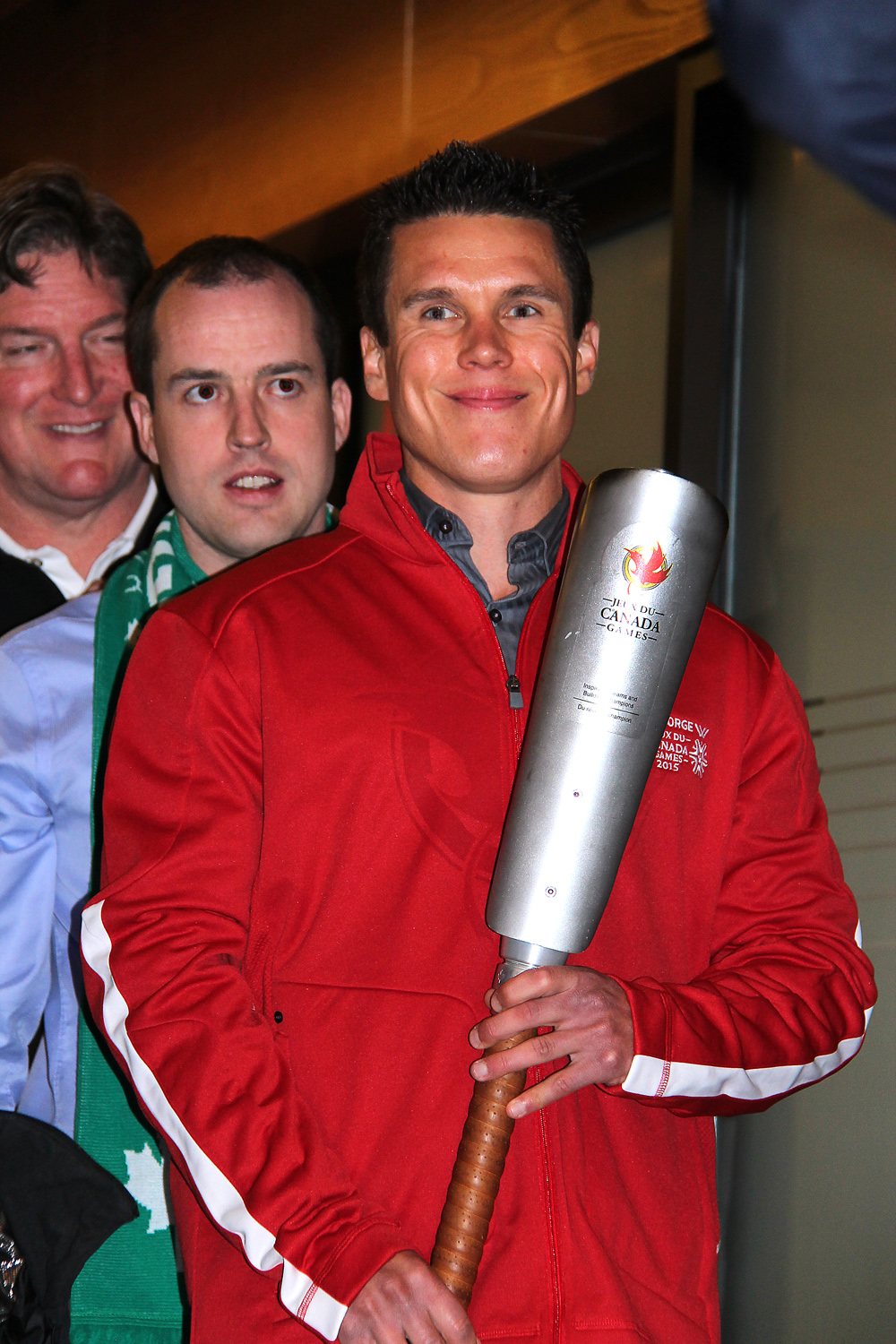2015 Canada Winter Games torchbearer Scott McWalter, right, with Jonathan Dyck, chair of the committee that chose the torchbearers for  the Games, and Games CEO Stuart Ballantyne at a ceremony Friday announcing the names of the 150 people who will carry the torch in northern B.C. prior to the Games opening in February in Prince George. Bill PHILLIPS/Free Press