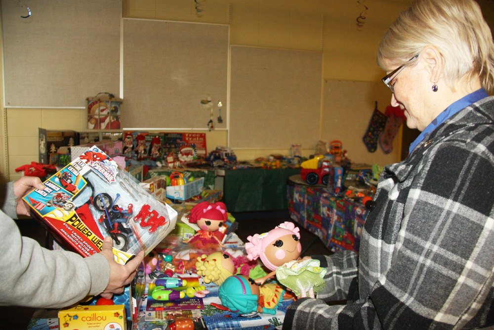 "The Prince George Elizabeth Fry Society's Family Resource Centre has found a unique way to bring gifts to their clients at Christmas by having them ""shop"" for gifts to give in room full of donated toys, winter clothing, household items and more. The event is on until Wednesday. Teresa MALLAM/Free Press"