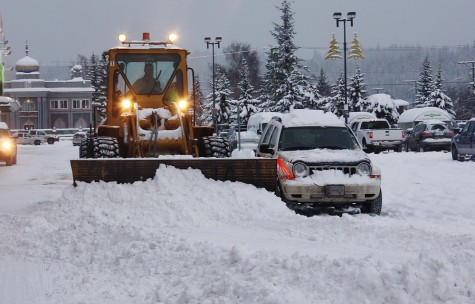 Now that take a steady hand on the wheel. Clearing snow from the parking lot at Spruceland Mall is certainly made tougher when cars are in the lot. This plow operator obviously has a steady hand on the wheel as he gets his blade within inches of a parked vehicle Tuesday morning. Bill PHILLIPS/Free Press