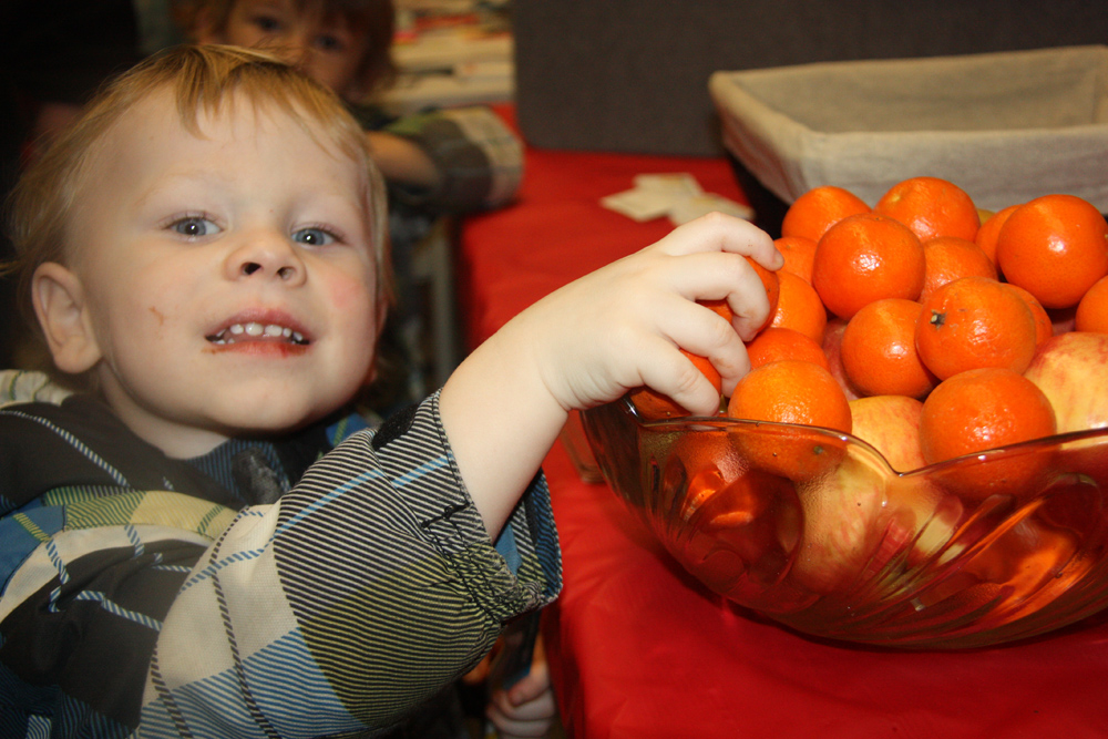 Damien Hornby, 2, reaches for a healthy snack Thursday at the Prince George Native Friendship Centre's third annual Health Fair. The event included several booths with health-related information, giveaway items like toothbrushes, a free hair styling and nails clinic and door prizes. Teresa MALLAM/Free Press