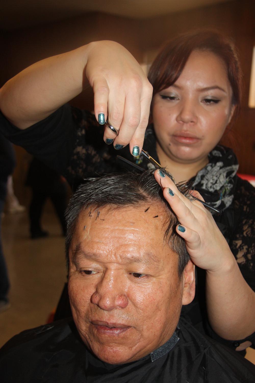 Eric Bolton Sr. gets a trim from hair stylist Megan Erickson (Loxx Academy of Hair Design) at the Prince George Native Friendship Centre's third annual Health Fair on Thursday.  Teresa MALLAM/Free Press