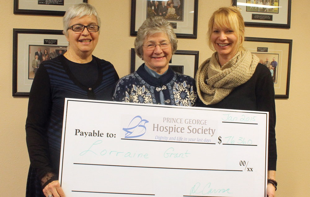 Hospice House of Prince George 50-50 winner Lorraine Grant, centre, receives a cheque for $76,360 from executive director Donalda Carson, left, and event co-ordinator Colette Garneau. Allan WISHART/Free Press