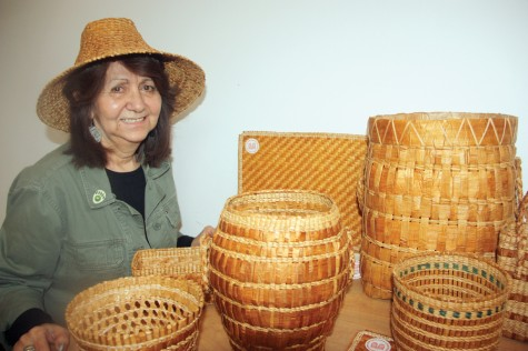 Artisan Dawn Ryland with some of her smaller baskets, bowls and placemats made in the traditional Haida Gwaii way, using woven strips of cedar bark. Ryland learned the technique from an elder of her clan. Teresa MALLAM/Free Press