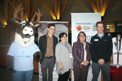 Northern Health mascot Spirit, left, joins Peter Stevenson of the Prince George Cycling Club, Anna Chisholm and Dr. Sandra Allison of Northern Health, and Mark Davis of the 2015 Canada Winter Games in announcing the latest round of Imagine grants on Tuesday at UNHBC. Allan WISHART/Free Press