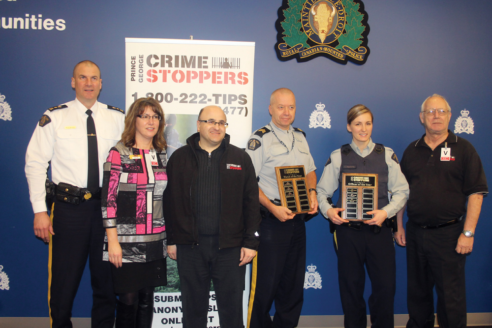 Prince George RCMP Supt. Warren Brown, left, and Crime Stoppers representatives Karen Young, Ron Polillo and Jack Hooper, right, recognize Cst. Candace Slaunwhite and Staff Sgt. Marc Pelletier (B Watch) with awards for their work with Crime Stoppers. Allan WISHART/Free Press