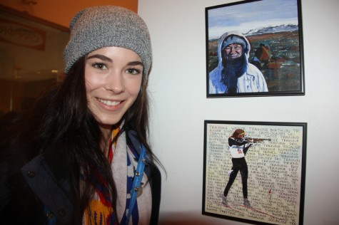 """Team B.C. biathlon Claire Lapointe with the piece she inspired entitled """"Claire Keeps Her Eye on the Target"""" by artist Mary Mottishaw. The mixed media work is part of a new group exhibit North: An Exhibition for the 2015 Canada Winter Games which opened at Two Rivers Gallery on Saturday. Teresa MALLAM/Free Press"""