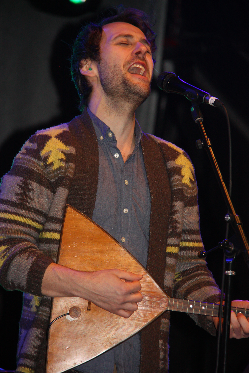 Adrian Glynn of Vancouver indie folk band The Fugitives, plays the balalaika, a Russian instrument that produces a sound similar to a mandolin. On the BCLC stage Monday night, Glynn told the Canada Games Plaza crowd that the instrument belonged to his Baba and it is over 100 years old.  Teresa MALLAM/Free Press