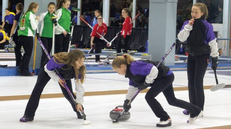 Team Yukon lead Karen Smallwood, left, and third Bayly Scoffin sweep the rock just delivered by second Peyton L'Henaff in their opening draw against the Northwest Territories on Monday at the Canada Winter Games. Allan WISHART/Free Press