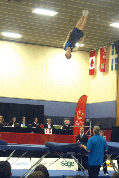 Jared Goad of Team Nova Scotia goes heels over head during the preliminary round of men's trampoline competition at the College of New Caledonia on Tuesday afternoon. Goad qualified for the finals, which were held Tuesday evening. Allan WISHART/Free Press