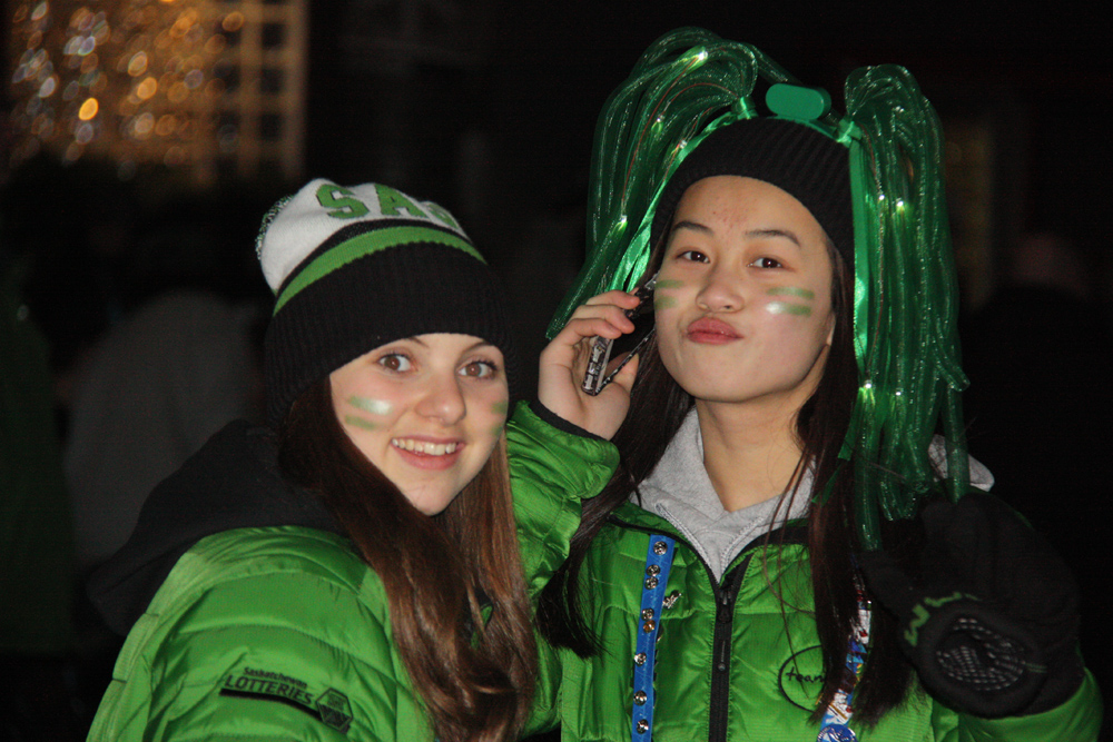 Girls just wanna have fun...and Nicki Nagg (left) and Ai Lin of Saskatchewan are making it last with a night out Saturday at Canada Games Plaza wearing glow-in-the-dark headwear and face-paint. Teresa MALLAM/Free Press