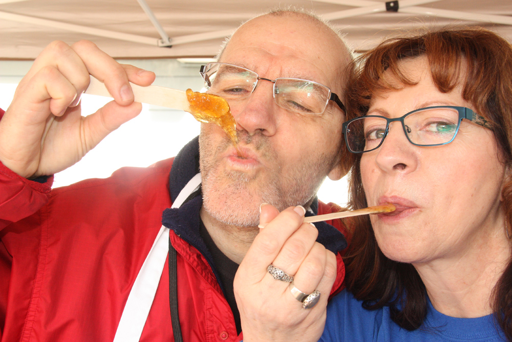 "Director Robert Doyon and executive director Renee Trepanier, enjoy the first ""taste testing"" batch of toffee on pristine snow Saturday at the annual FrancoFun Winter Festival. The event is hosted by Les Cercle des Canadiens Francais de Prince George.  Teresa MALLAM/Free Press"