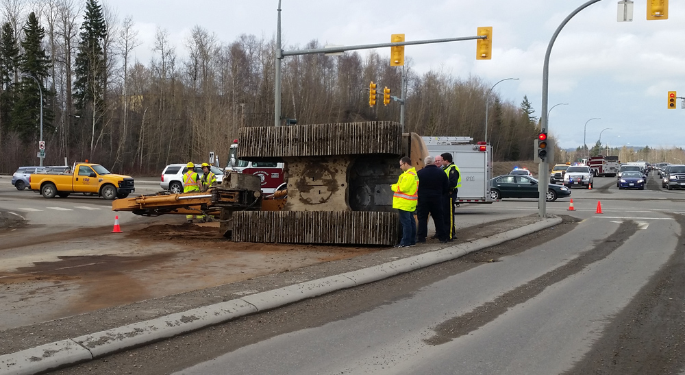 Traffic was snarled at the intersection of Highway 97 and Domano Boulevard Monday afternoon after low-bed carrying an excavator flipped on its side. Dayne CRAIG/Special to the Free Press