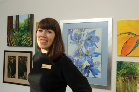 Maeve Hanna, assistant curator, Two Rivers Gallery, in her favourite part of a new exhibit called Rebirth which opens Thursday. The group exhibit, on display at Rustad Galleria, features work by done by talented local artists with Studio 2880's Artist's Workshop. Teresa MALLAM/Free Press