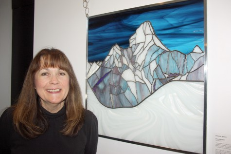 Artist Jeannette Spencer with her work Everest Reborn. The stained glass work which is showing in the group exhibit Rebirth on display at Rustad Gallery in Two Rivers Gallery, has its own amazing story of rebirth. Teresa MALLAM/Free Press