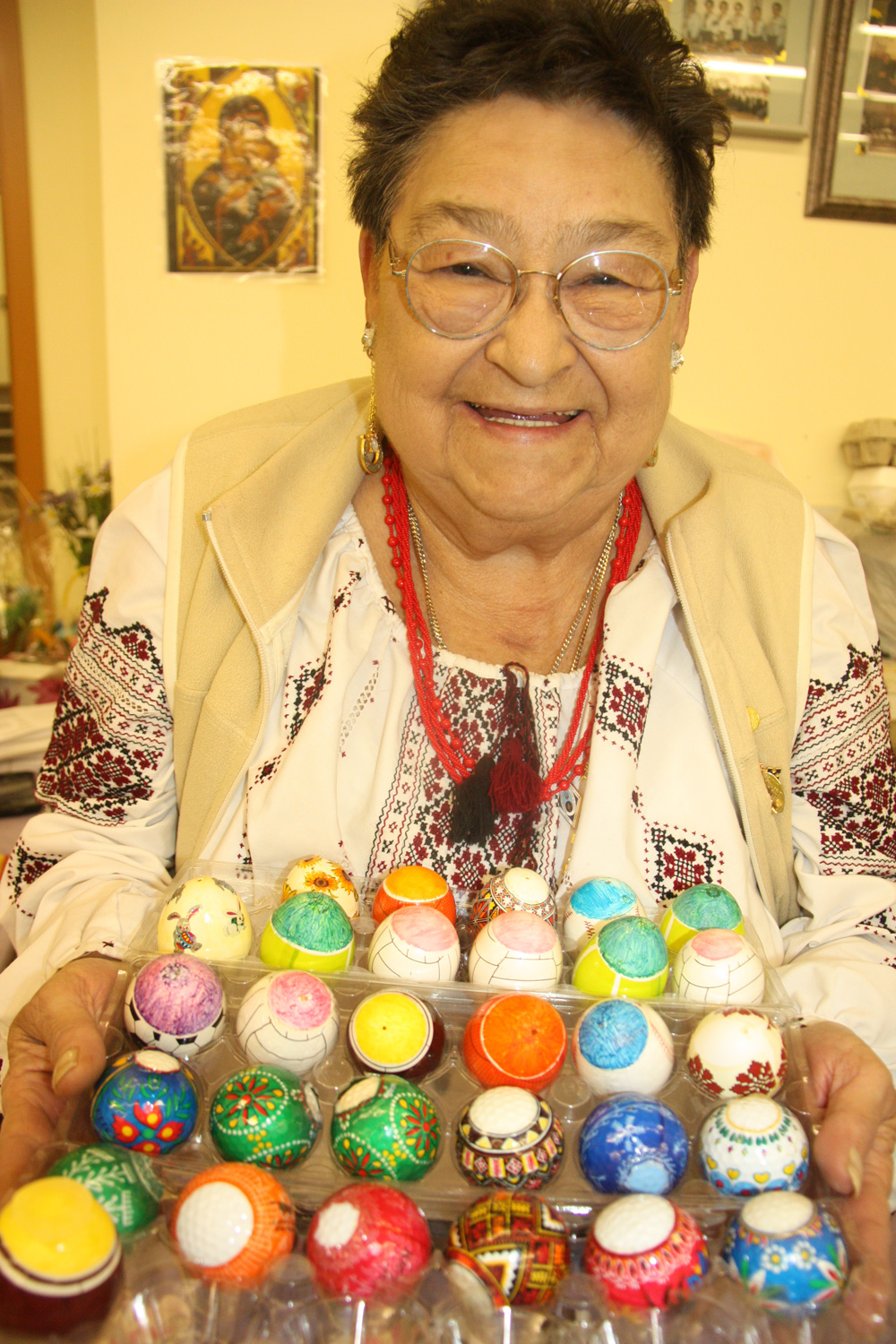 Artisan and crafter Rose-Marie Prokopchuk displays her unique Easter eggs on Sunday at St. George's Ukrainian Catholic Church Besides her traditional pysanky decorated eggs Prokopchuk paints her eggs to look like sports balls. Teresa MALLAM/Free Press