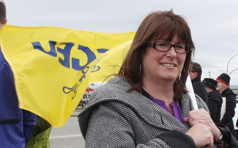 British Columbia Government and Service Employees' Union president Stephanie Smith joined a couple dozen protestors in Prince George Wedesday to mark the one year anniversary of expiration of the Canada Health Accord. The BCGEU is calling on the provinces and the federal government to negotiate a new accord. Bill PHILLIPS/Free Press