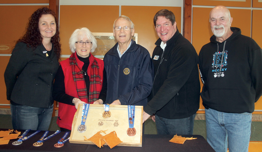 Tracy Calogheros of The Exploration Place, left, Shirley Gratton and Ron Neukomm of the Prince George Sports Hall of Fame, Stu Ballantyne, CEO of the 2015 Canada Winter Games, and Barry Williams of the Hall of Fame display the medals the Games donated Friday to the Hall and Exploration Place. Allan WISHART/Free Press