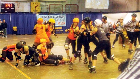 It was a hard-hitting affair between the Rated PG North Stars in orange and the Tournament City Derby Dolls from Kamloops during the Northern Exposure tournament at the Roll-a-Dome on the weekend. Tournament City won this match and downed Saskatoon for the title. Allan WISHART/Free Press