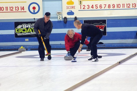 Bill Fisher comes out of the hack to release a rock during the Kelly Cup final on Sunday at the Prince George Golf and Curling Club. Fisher downed Scott Sherba to win his fourth Kelly Cup. Allan WISHART/Free Press