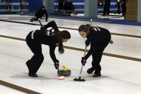 Bailey Eberherr, left, and Erin Ross of the Alyssa Connell rink put some effort into sweeping during the final game of the Ladies Bonspiel at the Prince George Golf and Curling Club on Sunday. The Connell rink downed Julia Shaddick to claim the title. Allan WISHART/Free Press
