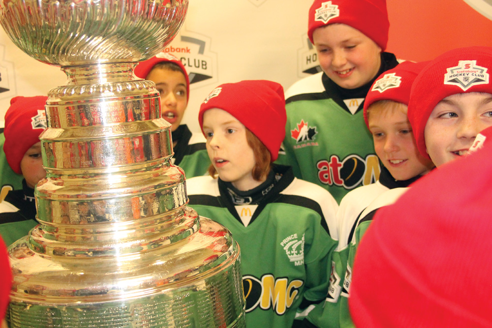 Jacob Doerkson and the rest of his Spruceland Scotiabank Atom teammates got to spend some time Wednesday evening with the Stanley Cup. The surprise visitor to their dressing room had the players looking to find Wayne Gretzky's name (not that hard) as well as a Vancouver team (the Millionaires from 1915). Scotiabank made the arrangements for the Cup to be there when the players came in for what they thought was going to be a team picture. It was, with one very important guest. Allan WISHART/Free Press