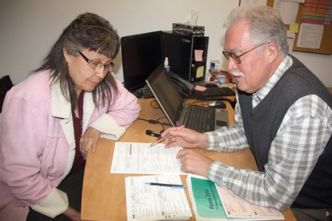 Francisca Leeson talks taxes with long time volunteer Paul Raines on Wednesday at the Salvation Army location. Raines, a retired teacher and principal with School District 57, is participating in the free community income tax preparation program which is geared to helping people with lower incomes. The program runs until the end of April. Google CRA tax clinic locations to find one convenient to you. Teresa MALLAM/Free Press