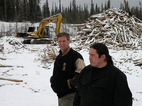 Former aboriginal relations Minister George Abbott and Tsay Keh Dene Chief Dennis Izony walk along the shore of Williston Lake, where masses of driftwood continued to pile up 44 years after the forested valley was flooded, February 2010. Tom Fletcher/Black Press