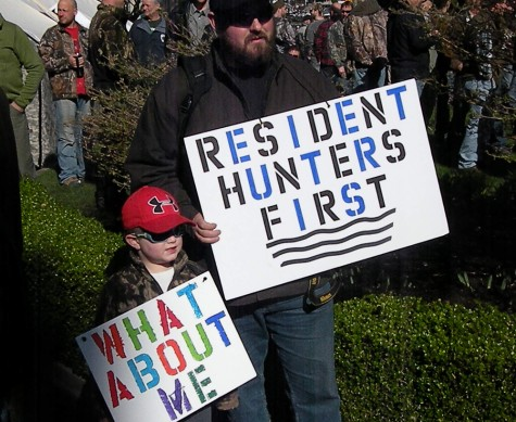 Greg Rensmaag and his son Connor travelled from Maple Ridge to Victoria to join a hunter rally at the B.C. legislature Monday March 2, 2015.