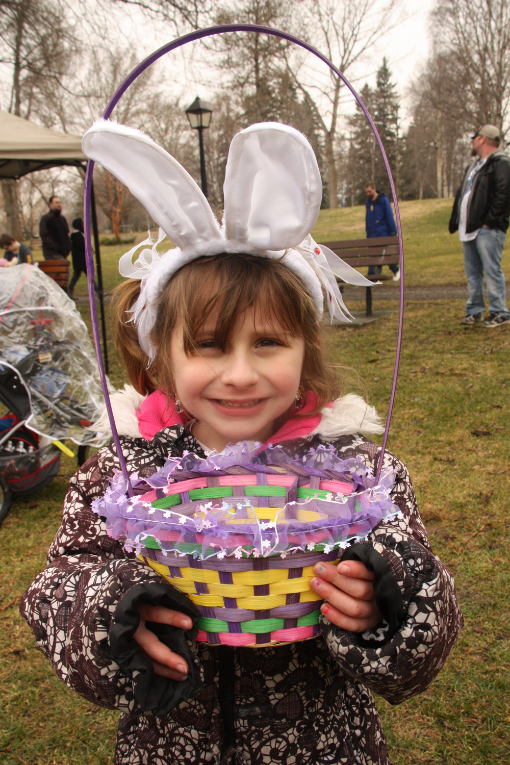 Rae Giergr, 6, has her basket and bunny ears ready to find the best eggs at Saturday's Easter Egg Hunt at Fort George Park. The event included games, mascots and prizes. Teresa MALLAM/Free Press