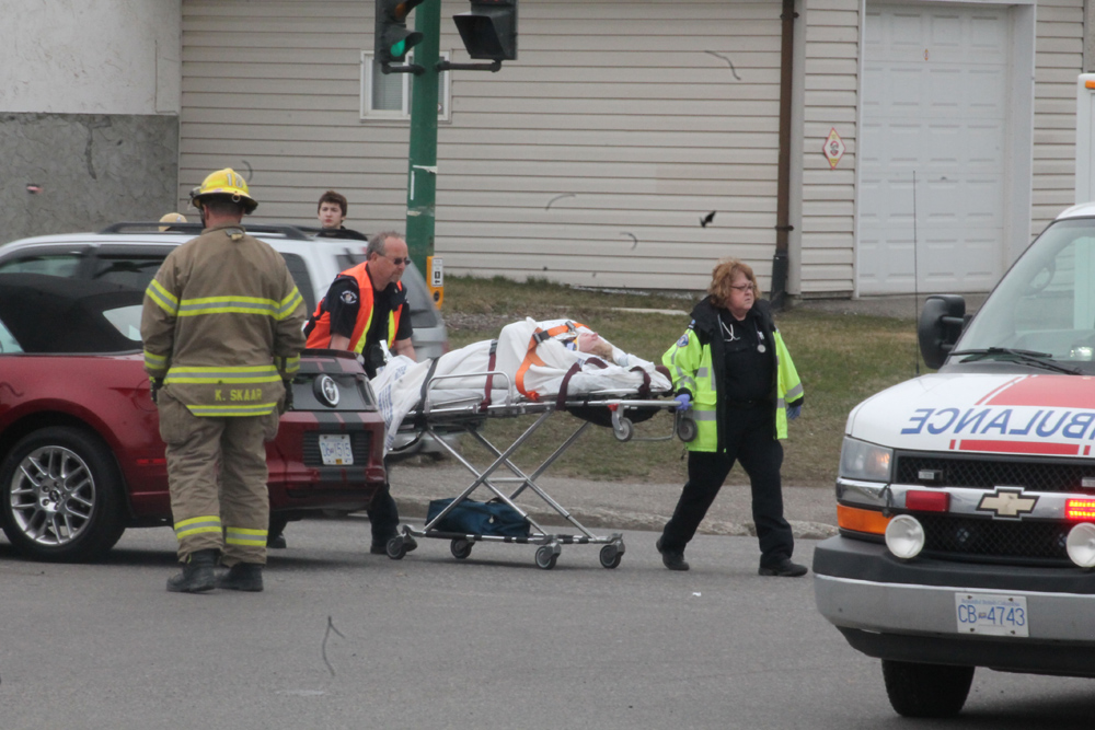 A collision between two vehicles at the corner of Ospika and Dufferin, across from Our Saviour's Lutheran Church around 3 p.m. Wednesday had people from the nearby neighbourhood running over to offer assistance. One person was taken from the scene which was attended by two ambulances and one fire and rescue team. Teresa MALLAM/Free Press