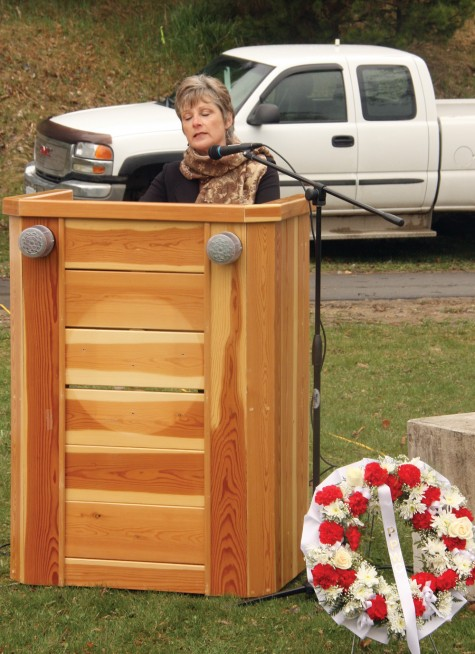 Lynne Rozenboom pauses to collect her thoughts as she speaks at the Day of Mounring ceremony Tuesday. Lynne's husband, Dirk, was killed in a helicopter crash in Cranbrook in 2008. Allan WISHART/Free Press
