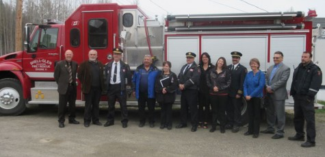 Representatives from Lheidli T'enneh, Regional District and the Shell-Glen Volunteer Fire Rescue pose in front of the fire truck at the Lheidli T'enneh Band office.