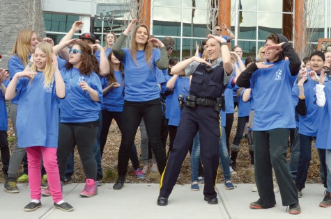 Const. Sonia Blom joins local students in a flash mob outside the Prince George RCMP Detachment on Monday morning. Courtesy Prince George RCMP