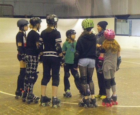 Rated PG Roller Brats coach Yard sale, right, talks to some of the skaters before a recent practice. The Roller Brats are on the track Saturday for a match against Gold Pain City from Quesnel. Allan WISHART/Free Press