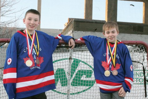 Prince George Peewee hockey players Jacob Ross, left, and Nicolas Braaten show off the medals they won in Europe as members of the Canadian Explorers. Allan WISHART/Free Press