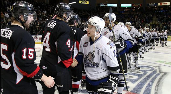 Prince George Cougars shake hands with the Victoria Royals following a 5-4 overtime loss in Victoria Saturday, bringing the Cougars' season to an end.